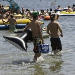 Thousands participate in reverse evolution by returning to the ocean with alcohol.