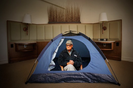 A satisfied customer enjoys his $19 room at the Rancho Bernardo Inn.